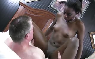 Black chick that enjoys to ride cock is pulling a white one with her hands